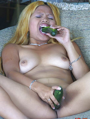 Sweet Asian's lusty wet hole is hungry for cucumber sex
