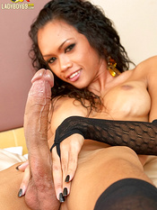Curly haired and winning tranny is doing unstoppable handjob