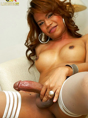 Curly haired and daring tranny is demonstrating her dick